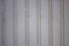 Old dirty white gray beige wall fence from wooden boards. vertical lines. rough surface texture. A old dirty white gray beige wall fence from wooden boards royalty free stock photos