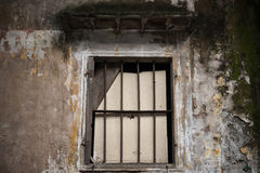 Old dirty window on dirty wall Royalty Free Stock Photos