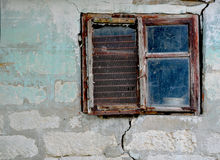 Old dirty window on old dirty wall Stock Photo