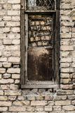 Old dirty window on old dirty wall Stock Photography