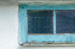 Old dirty window. In village Stock Images