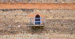 Old dirty window on wall. Old dirty window on old dirty wall Royalty Free Stock Image