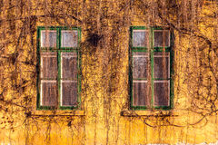 Old dirty windows on old dirty wall Royalty Free Stock Photos