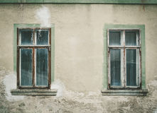 Old dirty windows. Two old closed dirty wooden windows Royalty Free Stock Photos