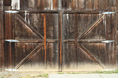 Old and Dirty Wooden Gate. A dirty wooden gate of an old barn or workshop Stock Photo