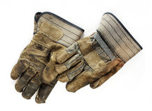 Old Dirty Work Gloves. A pair of old, dirty canvas and leather work gloves on a white background royalty free stock photography