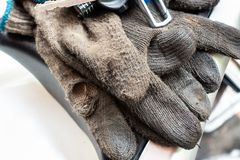Old dirty working man`s glove. Repair protection wear.  Royalty Free Stock Image