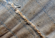 Old dirty worn jeans with rough stitch. Abstract background and texture fr design Royalty Free Stock Photos