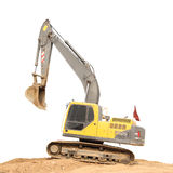 Old dirty yellow backhoe and brown soil Stock Image
