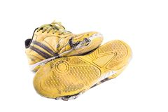 Old dirty yellow  football shoes damaged on white background football  object isolated