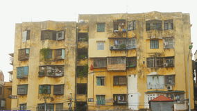 Old dirty yellow residential house in Hanoi. Vietnam. stock video footage