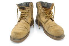 Old dirty yellow working boots Royalty Free Stock Photography