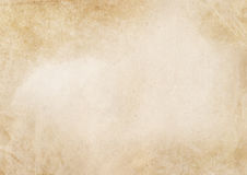 Old dirty yellowed paper texture. Aged and yellowed paper background. Vintage paper texture for the design Stock Photography