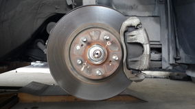 Old disc brake and caliper. On car Stock Images