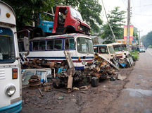 Old discarded buses. Garbage, old buses and a lot of trash on the street in Kandy Royalty Free Stock Photo