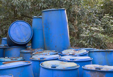 Old discarded plastic barrels Royalty Free Stock Images
