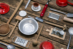 Old dishes and cutlery on a wooden background in red, silver and