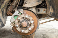 Old disk brake repair in the garage, mini-truck Royalty Free Stock Images
