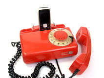 Old disk telephone set and mobile phone.  Royalty Free Stock Photography