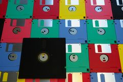 Old diskette 5 25 inches with 3.5 floppy disks of various colors. Stock Image