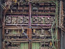 Old dismantled and rusty electrical panel assembly. Close view stock images