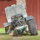Old dismantled tractor front view. Old dismantled tractor with removed engine compartment hood and visible fan front view Stock Photos