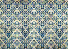 Old distressed blue damask wallpaper stock image