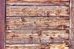 Old Distressed Brown Terracotta Copper Rusty Wooden Background with Rough Texture Multicolored Inclusions. Stained. Gradient Coarse Grainy Surface. Wallpaper stock photos