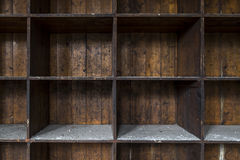Old, distressed, empty wooden storage shelves Royalty Free Stock Image