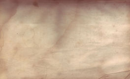 Old Distressed Paper. Vintage distressed paper with stains, burn marks and rips royalty free stock photography
