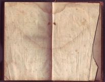 Old Distressed Paper. Vintage distressed paper with stains, burn marks and rips royalty free stock image