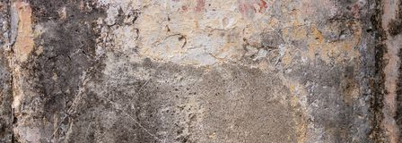 Old, distressed wall, building facade texture background. Old, distressed wall, building facade. Painted and faded, gray color masonry, texture background royalty free stock image