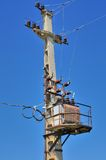 Old distribution transformer on concrete power pole Stock Images