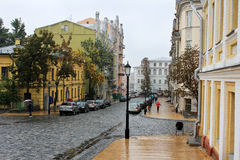 Old district of the city in the rain. Kiev. Ukraine. Andrews descent. Historic district Stock Photos