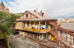 Old district of georgian capital with wooden houses and narrow streets Stock Images