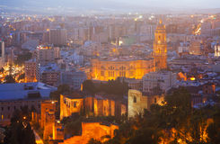 Old districts in Malaga with Cathedral in night Stock Photos
