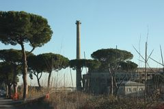 Old disused factory with chimney royalty free stock image