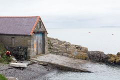Old disused lifeboat station at Moelfre. In Anglesey, North Wales Stock Photo