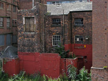 An old disused Mill. An old broken and  disused mill in the hart of Manchester Stock Image