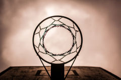 Old disused outdoor basketball hoop from below Stock Photos