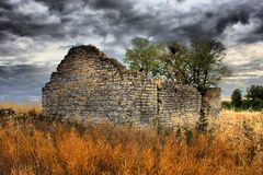 An old disused stone barn in farmland Royalty Free Stock Photo