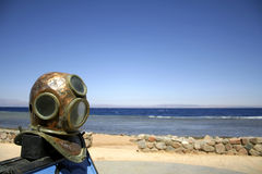 Old diving helmet red sea Royalty Free Stock Photo