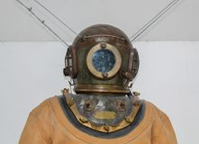 An old diving helmet with diving suit. royalty free stock photography