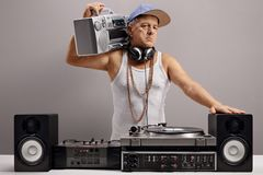 Old DJ with a boombox and musical equipment Royalty Free Stock Image