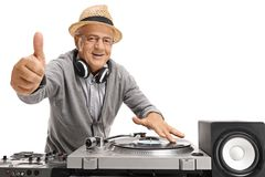 Old DJ making a thumb up gesture Stock Photos