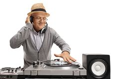 Old DJ playing music on a turntable Stock Image