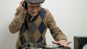 Old DJ scratching on a turntable stock footage
