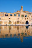 The old dock building at Bormla (Cospicua) waterfront. Malta. Royalty Free Stock Image