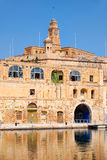 The old dock building at Bormla (Cospicua) waterfront. Malta. Stock Image
