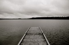 Old dock on Laurie Lake in black and white. Old dock on Laurie Lake, duck Mountain Provincial Park, Manitoba royalty free stock photography